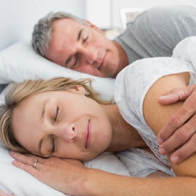 Image of an older couple sleeping peacefully after sleep apnea therapy