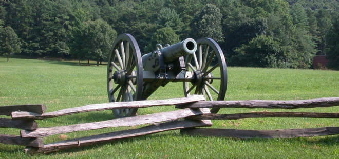 Image of civil war canon with Kennesaw Mountain in the background