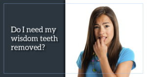 Young woman biting her finger nail with the questions, do I need my wisdom teeth removed?