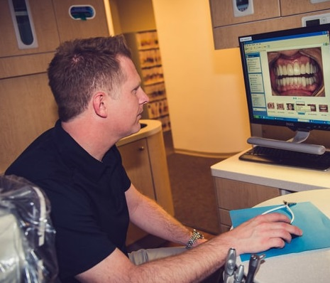 Dr. Eric Duncan using technology to create a beautiful smile makeover for his Kennesaw, GA patients